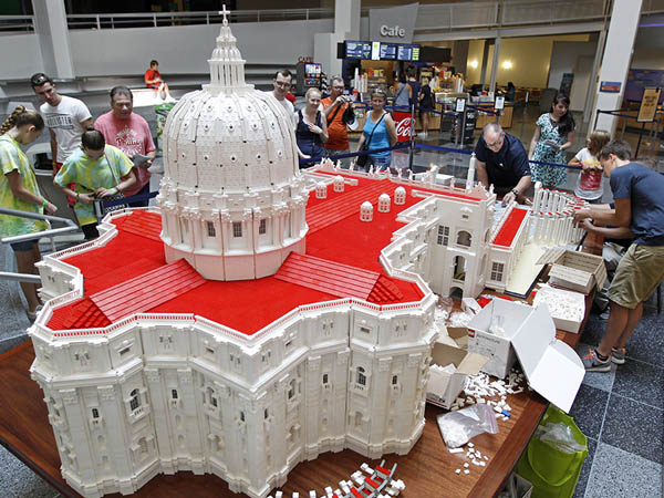 Father Bob Simon, a priest with the Diocese of Scranton, works on his Lego replica of St. Peter's Cathedral at the Franklin Institute Tuesday, September 1, 2015. He and a friend began building the the Lego Vatican a year ago in anticipation of the pope's Philadelphia visit. MICHAEL BRYANT / Staff Photographer