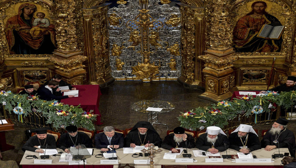 Ukrainian President Poroshenko and clergymen attend a church council to convene to create an independent Ukrainian Orthodox church in Kiev Ukrainian President Petro Poroshenko and clergymen attend a church council to convene to create an independent Ukrainian Orthodox church at the Saint Sophia's Cathedral in Kiev, Ukraine December 15, 2018. Mykola Lazarenko/Ukrainian Presidential Press Service/Handout via REUTERS ATTENTION EDITORS - THIS IMAGE WAS PROVIDED BY A THIRD PARTY. HANDOUT