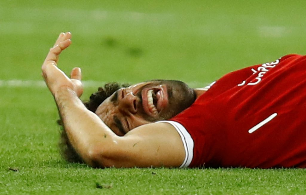 Champions League Final - Real Madrid v Liverpool Soccer Football - Champions League Final - Real Madrid v Liverpool - NSC Olympic Stadium, Kiev, Ukraine - May 26, 2018   Liverpool's Mohamed Salah reacts after sustaining an injury                    REUTERS/Kai Pfaffenbach KAI PFAFFENBACH