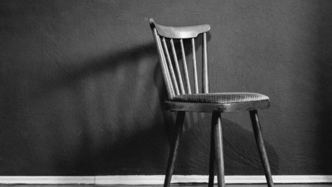 grayscale photo of wooden chair