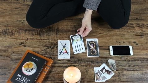 person playing with tarrot cards